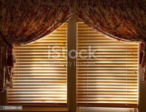 Wooden venetian blinds, curtains