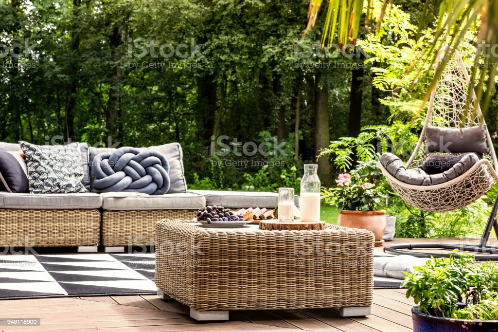 Wooden veranda with hanging chair