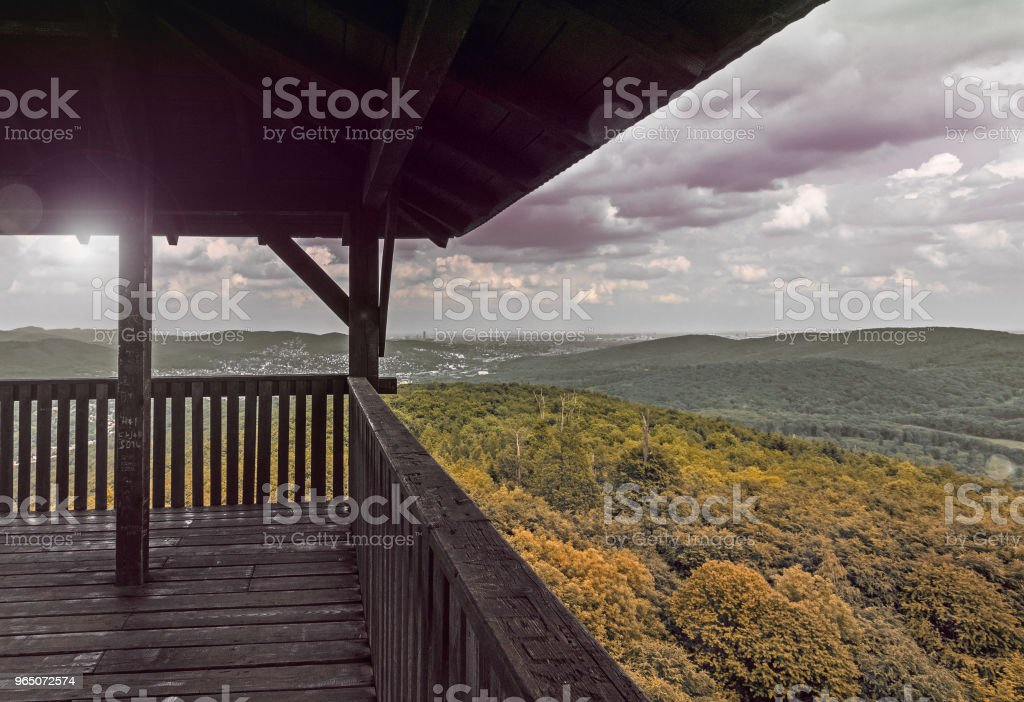 wooden viewing platform, observation point, panoramic view of autmn hills and cloudy sky royalty-free stock photo