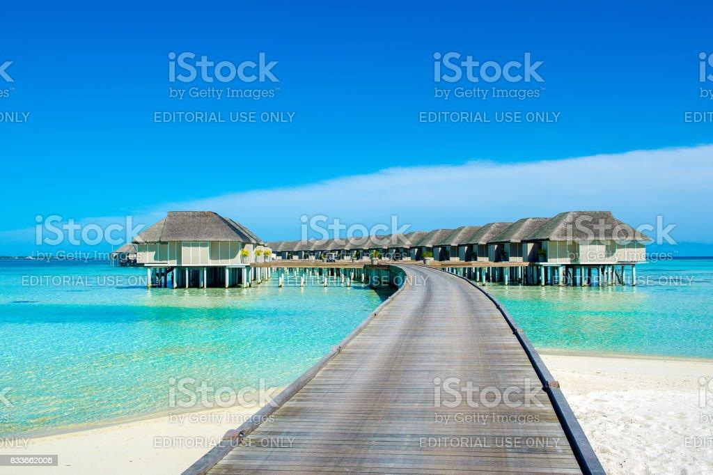 Wooden villas over water stock photo