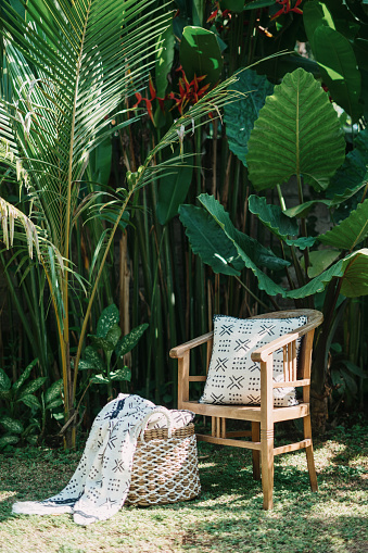 Wooden vintage armchair  and decor against green background