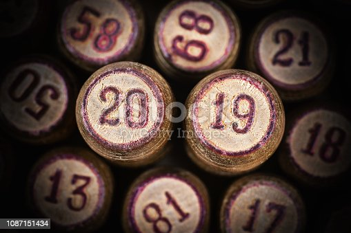 istock Wooden vintage lotto kegs with two numbers 20 and 19 as symbol of 2019 New Year 1087151434