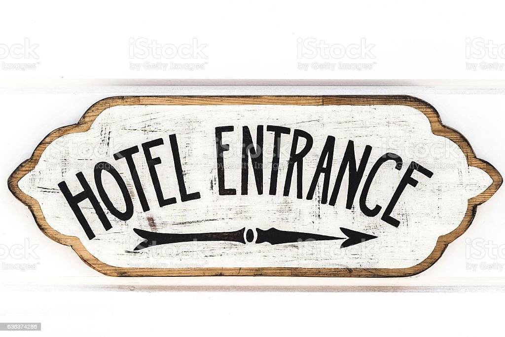 Wooden vintage plate with sign Hotel Entrance isolated on white - foto de acervo