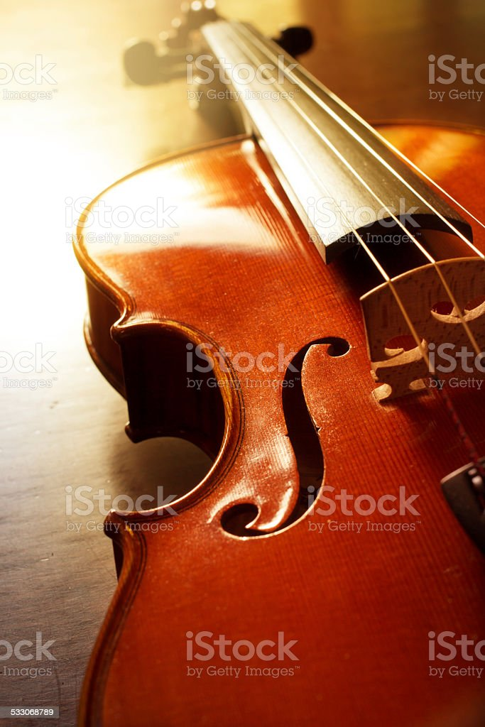 Wooden violin with sun light. stock photo