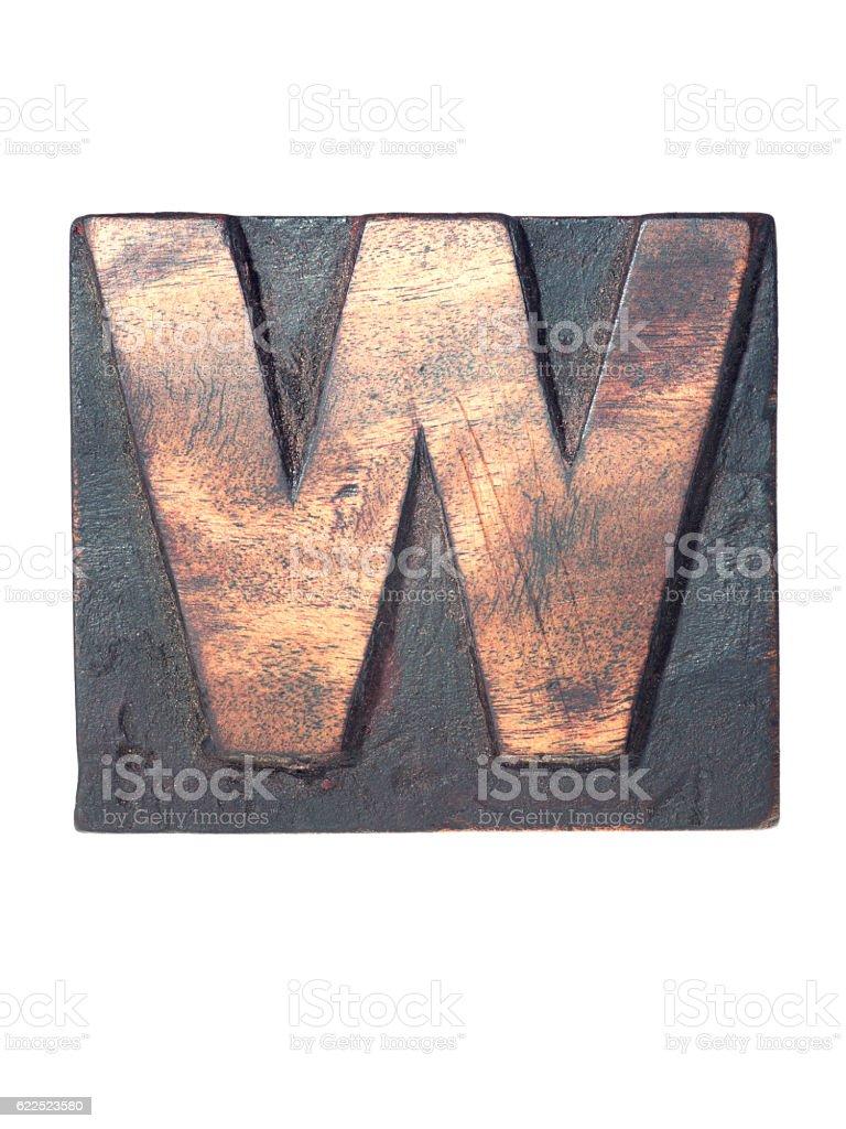 wooden W typeface stock photo