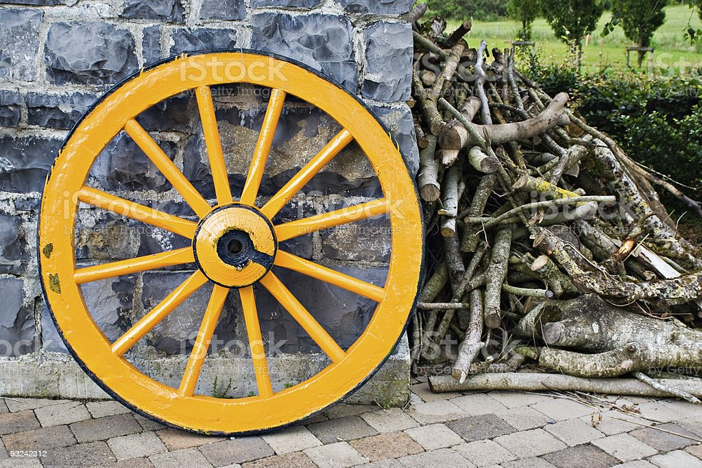 Wooden Wagon Wheel and Branches royalty-free stock photo