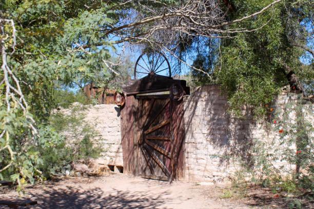 Wooden wagon wheel gate stock photo