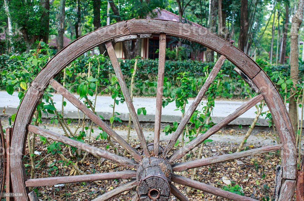 Wooden Wagon Wheel In Garden Stock Photo Download Image Now Istock