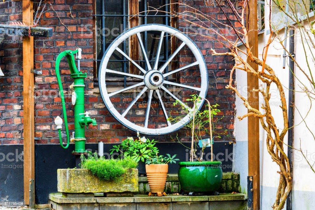 Wooden Wagon Wheel Wall Decor from media.istockphoto.com