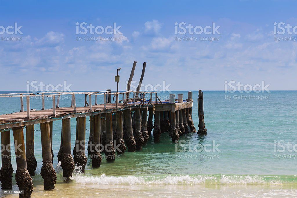 Wooden waling way leading to the sea stock photo