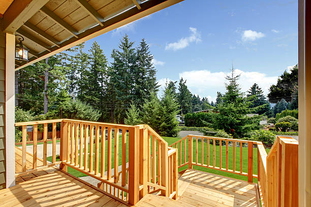 Wooden walkout deck with patio area stock photo