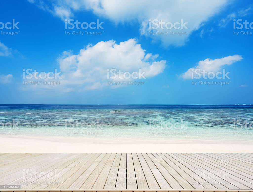 Wooden walkway beside tropical beach stock photo