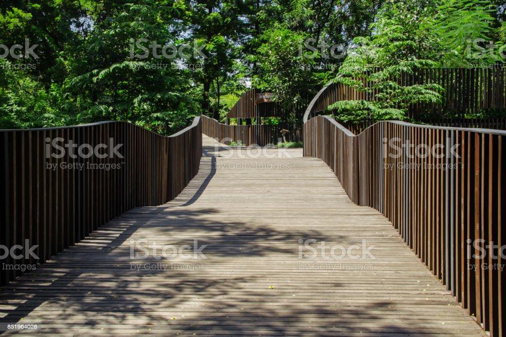 wooden walkway in the park stock photo