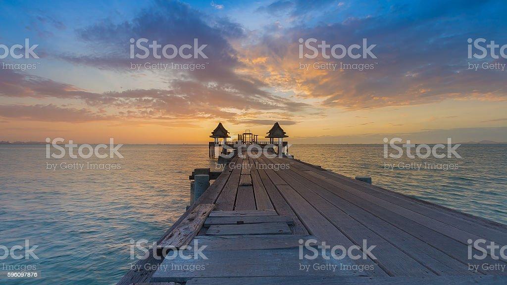Wooden walkway leading to ocean skyline royalty-free stock photo