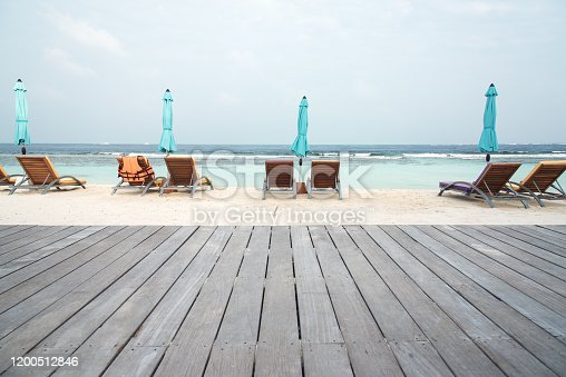Wooden walkway on the sand beach