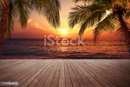 Wooden walkway on the sunset beach