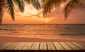 Wooden walkway on the sunset beach