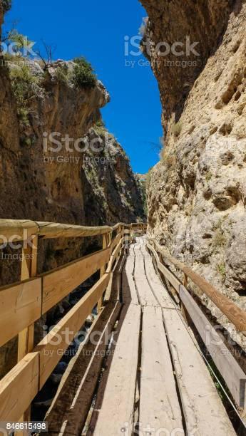 Wooden walkway through a narrow gorge at sierra de castril national picture id846615498?b=1&k=6&m=846615498&s=612x612&h=uych1pfbcc ajr 72szdkr8ekjku10hfhlsuqffzufy=