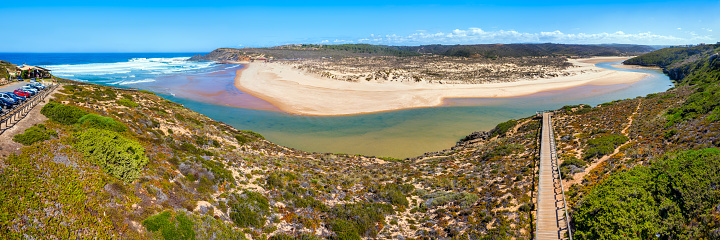 panoramic view of Praia da Amoreira with Wooden walkway to the beach  and river, vicentine coast, Aljezur, Algarve, Portugal