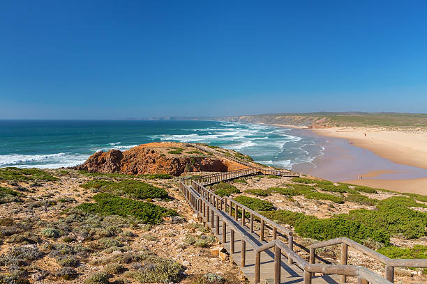 wooden walkway to the beach praia da amoreira, district aljezur. - amoreiras imagens e fotografias de stock