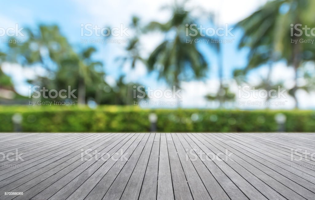 Wooden walkway with tropical garden abstract background stock photo