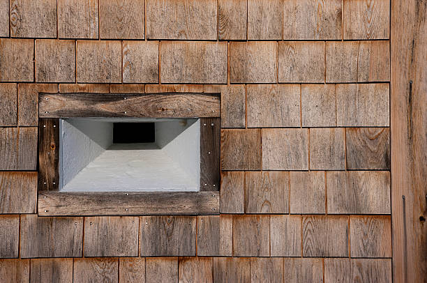 Wooden wall and porthole of the historic Edgecomb Fort, Maine stock photo