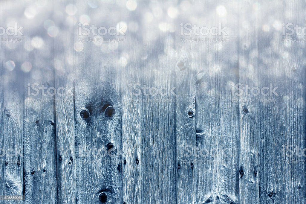 wooden wall and snowflakes stock photo