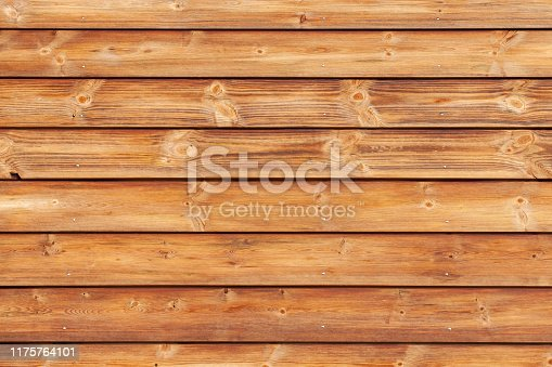 Natural wooden wall made of toned pine tree planks. Frontal flat background photo texture