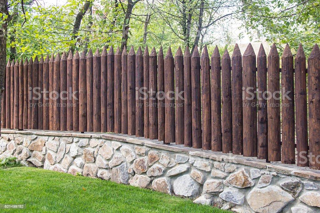 Wooden wall with brick base photo libre de droits