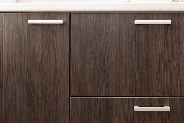 wooden wardrobe drawer front, metal handle - griffe für küchenschränke stock-fotos und bilder