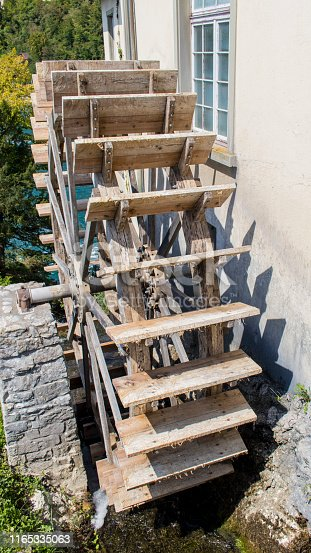 A Wooden Waterwheels produces Energy