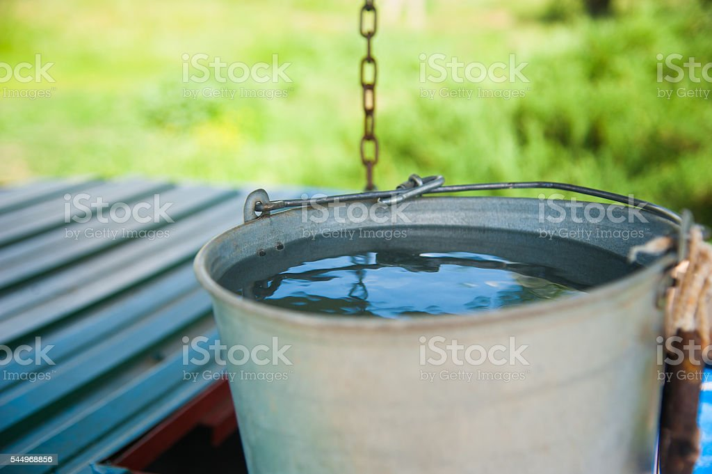 Wooden well water stock photo