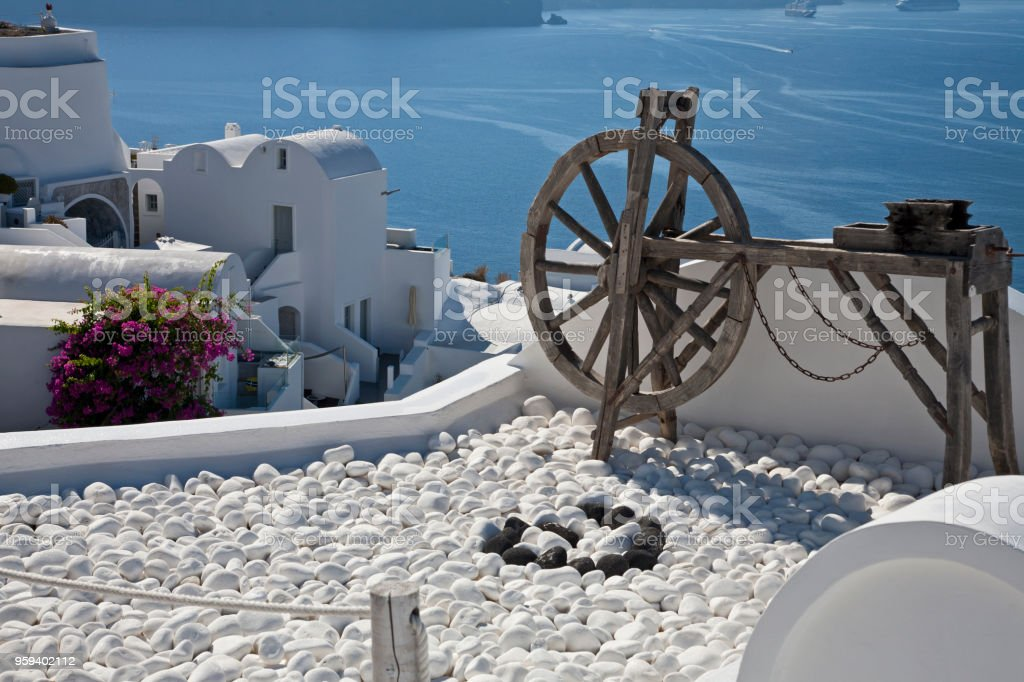 Wooden Wheel on the Roof stock photo