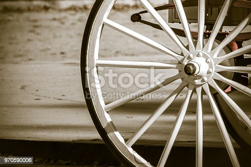 Wooden wheel of a horse drawn carriage.