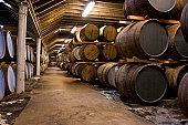 Wooden whisky barrels in a famous scottish distillery.