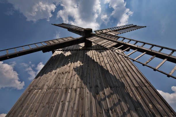 wooden windmill in poland. - low angle view foto e immagini stock