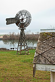 istock Wooden windmill on bank of Macquarie River near Longford 152182882
