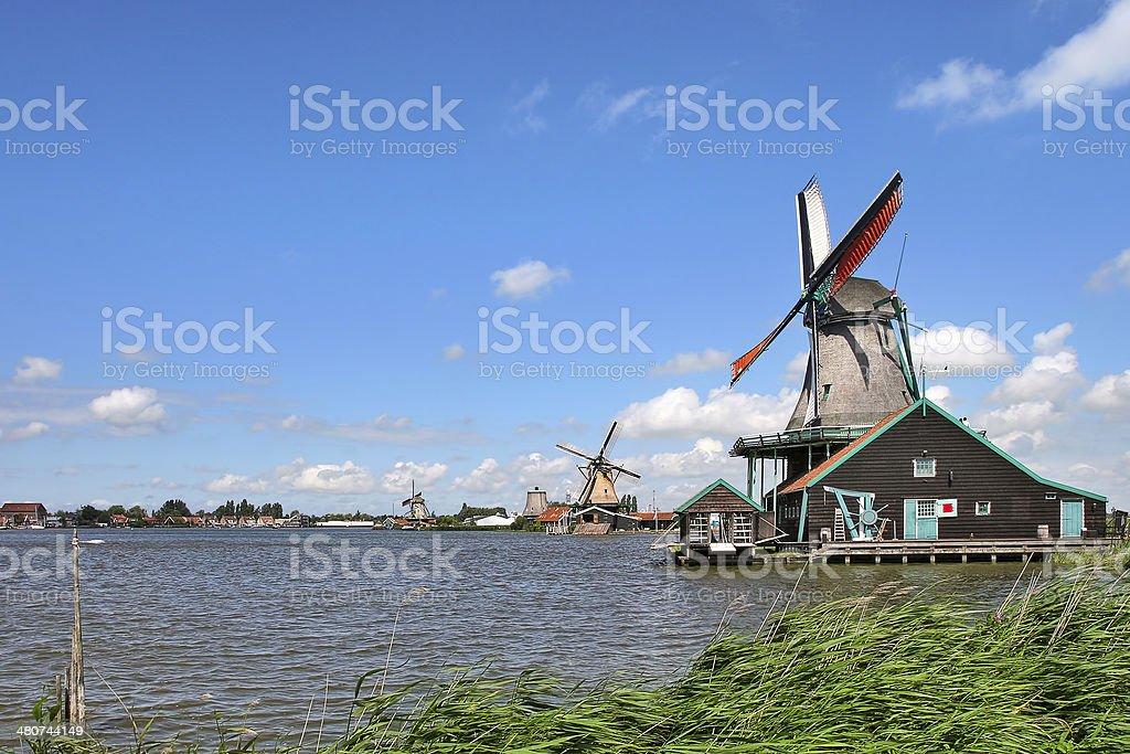 Wooden windmills in dutch village. royalty-free stock photo