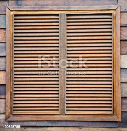 1124475954 istock photo wooden window and vintage wall 490658755