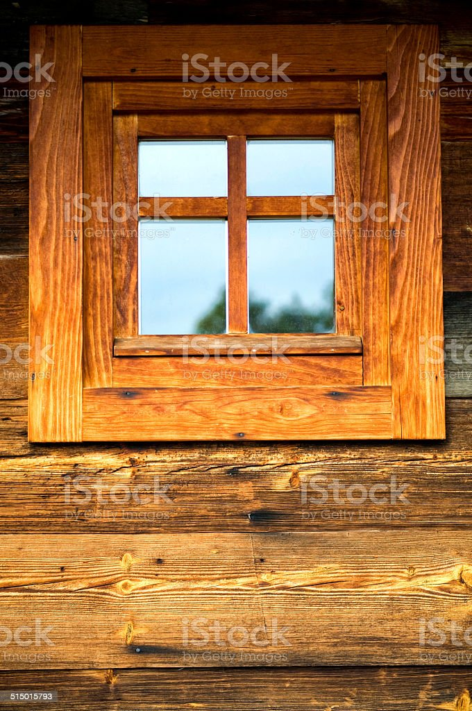 Wooden window at wooden wall, old Balkan architecture style stock photo