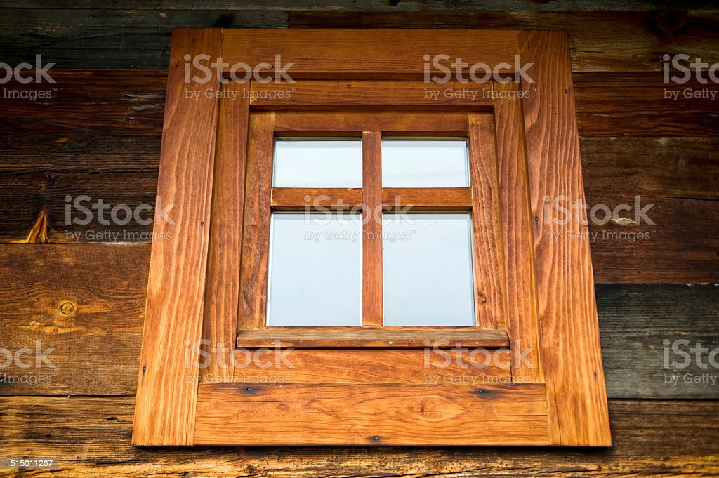 Wooden window at wooden wall stock photo