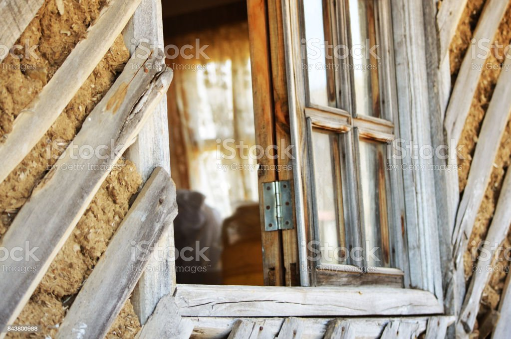 Wooden window frame close up photo in a countryside cabin stock photo