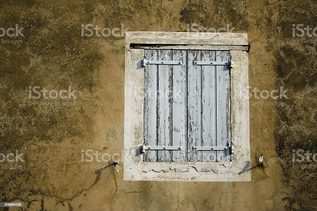 wooden window shutters peeling paint royalty-free stock photo