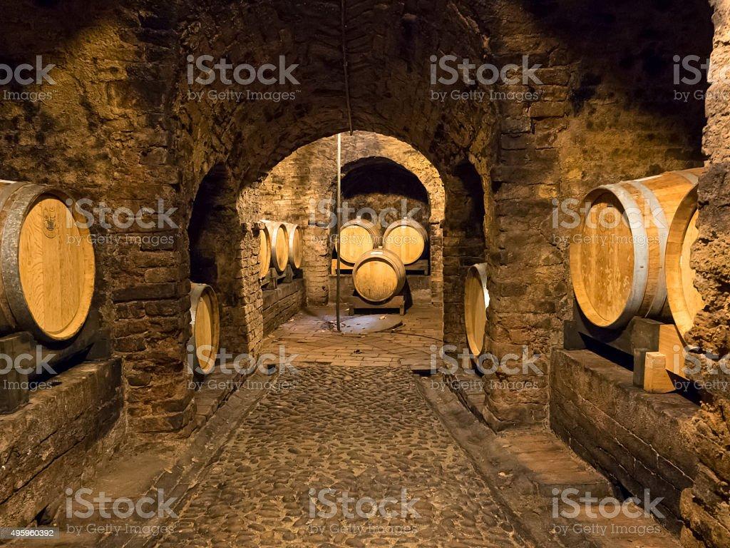 Wooden wine barrels in a wine cellar stock photo