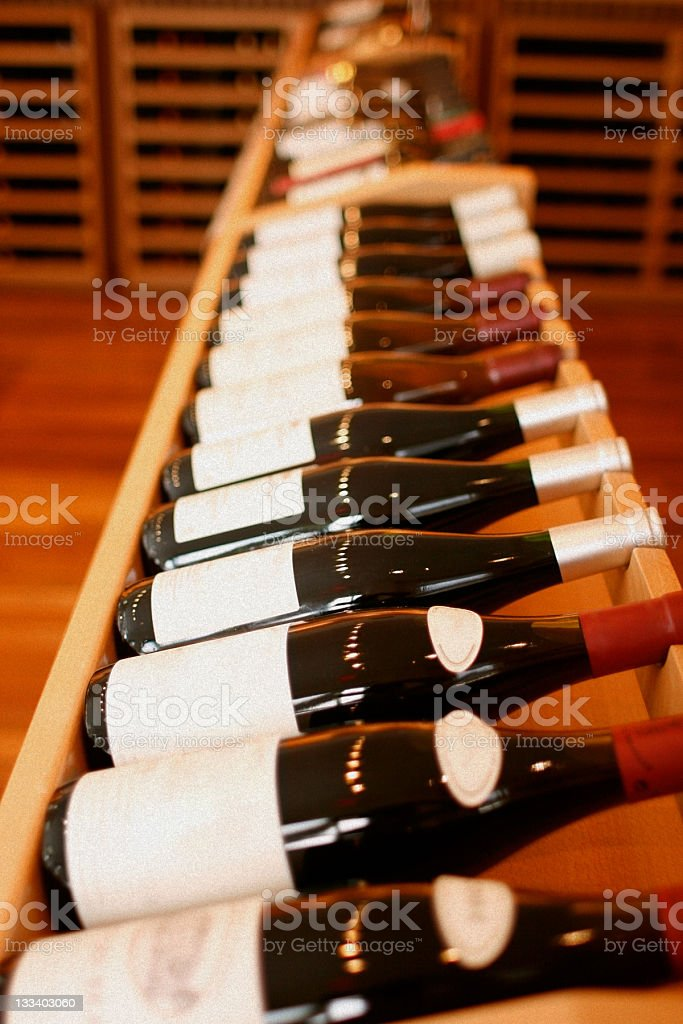 Wooden Wine Rack - Bottles on Side royalty-free stock photo