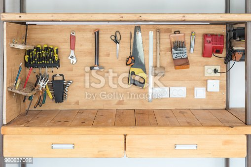 1155772265 istock photo Wooden workbench at workshop. Lot of different tools for diy and repair works. Wood desk for product display. Copyspace. Labour day 960637026