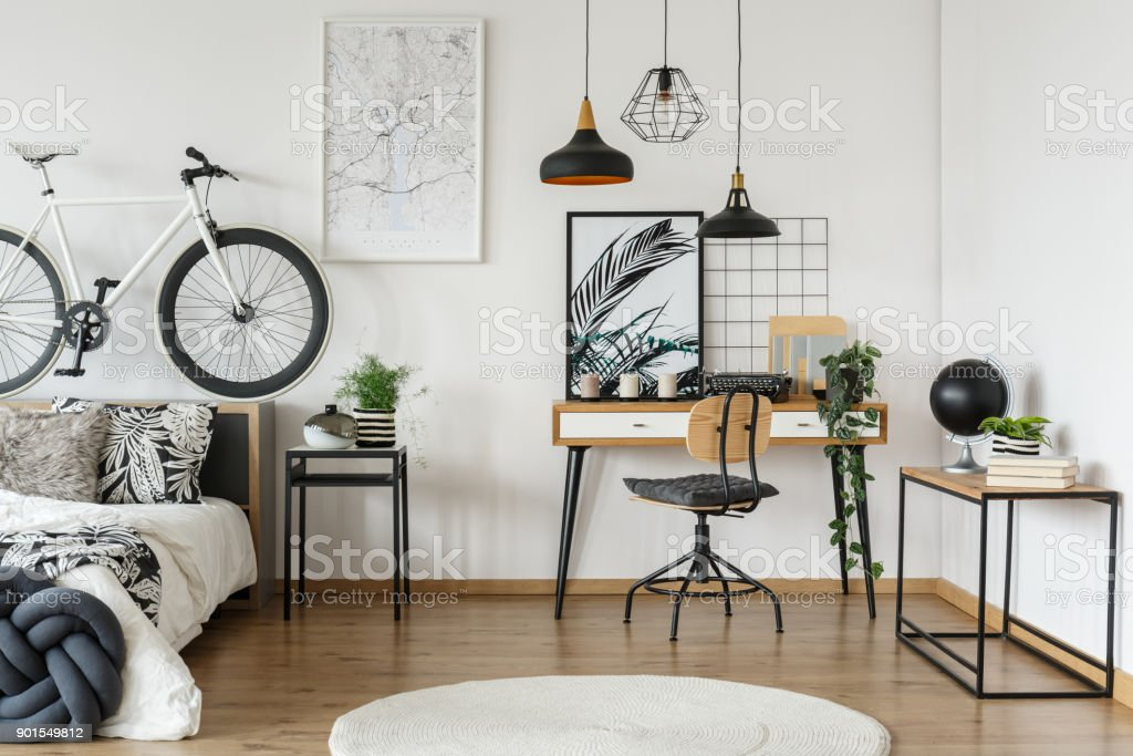 Wooden workspace in floral bedroom stock photo