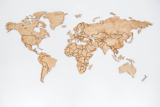 Wooden world map on a white wall. Geography concept. Background for travel. Logistics and transportation, worldwide business. All continent. Europe, America, Australia and Asia. stock photo