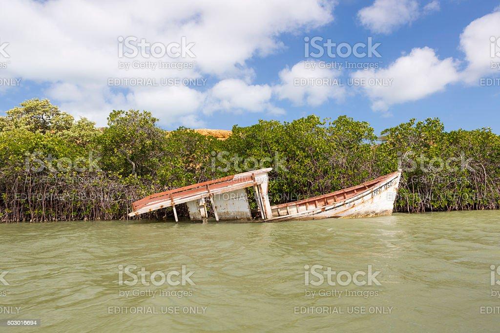 Wooden wreck boat sinking in La Guajira, Colombia stock photo