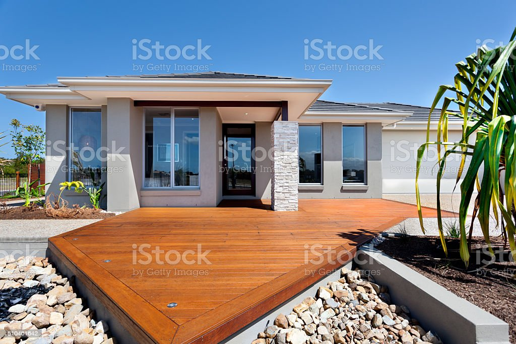Wooden yard with big rocks around a modern mansion stock photo